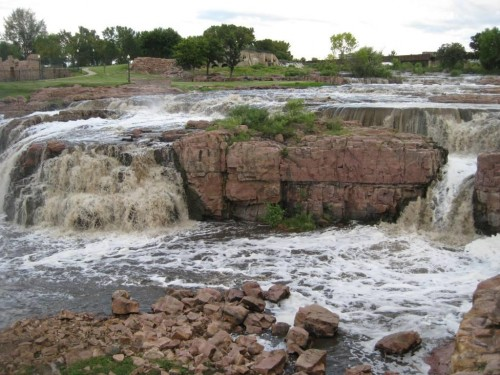 "Sioux Falls, South Dakota: ""I step out on a dry slab of rock. Below me a small vortex has formed, water trapped in a circular flow. It strains to break free, to join its brethren in downward motion. I understand that feeling."""